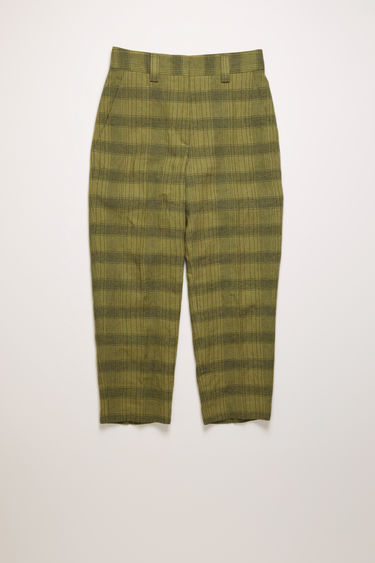 Acne Studios green/grey trousers are crafted from a linen blend that's woven with the seasonal check pattern and are shaped with tapered legs and a mid-rise waist.