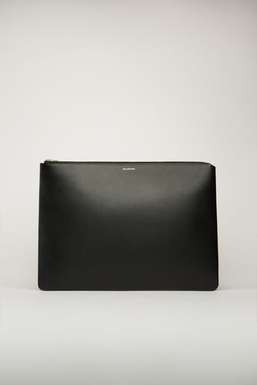Acne Studios black document holder is crafted from soft grained leather with a silver stamped logo and features a metal zip fastening that opens to reveal a leather-lined interior to store your documents and tech accessories.