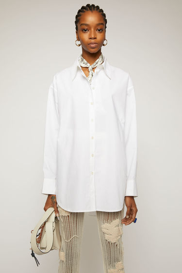 Acne Studios white shirt is crafted from cotton poplin with an oversized fit and finished with a point collar.