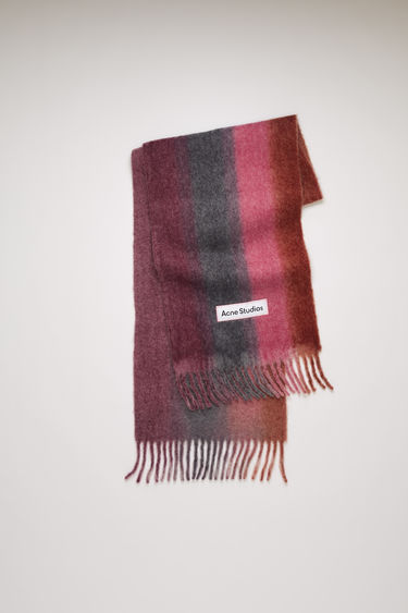 Acne Studios purple/pink scarf is spun from a soft blend of alpaca, wool and mohair to a wide dimension. It's patterned with gradient stripes and features a stitched logo patch above the fringed edges.