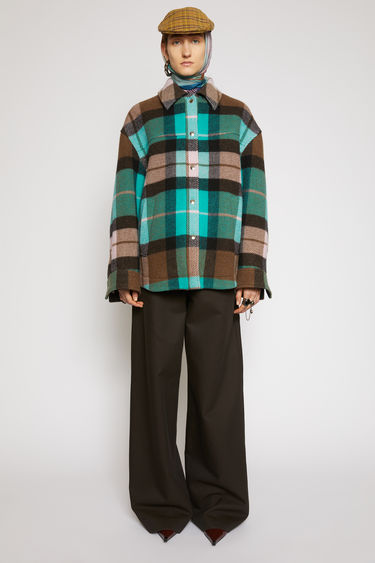 Acne Studios turquoise/brown overshirt is made from heavyweight wool-blend that's woven with checks. It's crafted to an A-line shape with voluminous sleeves and a curved hemline and has big, slanted welt pockets and silver snap buttons.