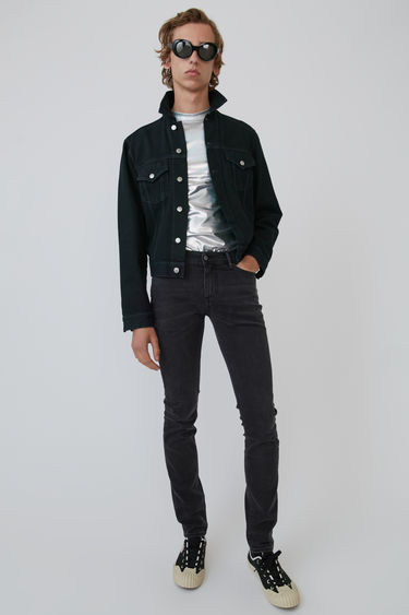 Acne Studios 1998 Black Overdye denim jacket is cut to a slim fit and finished with silver-tone logo-embossed buttons and tonal topstitching.