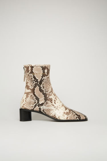 Acne Studios beige/black boots are crafted from python-print leather to a sung sock-like fit and set on a stacked block heel. They're secured with a metal zip and accented gold stamped logo on the ankle.