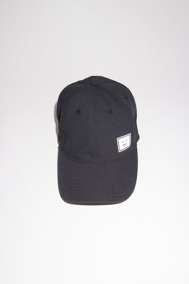 Acne Studios black baseball cap is made from structured twill with a reflective face logo patch.