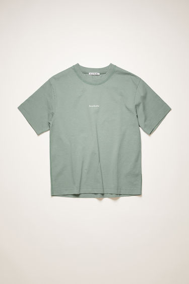 Acne Studios dusty green t-shirt is made from pigment-dyed jersey that's lightly faded along the seams. It's cut to a relaxed silhouette with dropped shoulders and features a raised logo print on front.