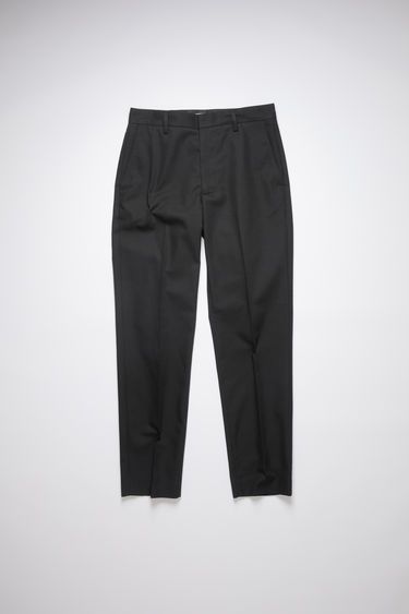 Acne Studios black cotton-twill trousers are tailored for a slim fit with a straight-leg shape, and have belt loops, slip pockets and two back jet pockets.