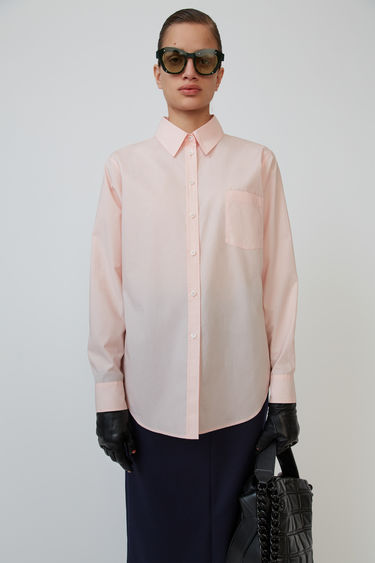Acne Studios pastel pink classic shirt is made from cotton and accented with a logo embroidery.