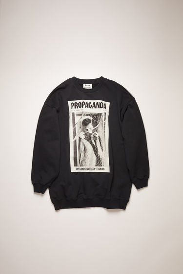 Acne Studios faded black sweatshirt is crafted for an oversized fit from midweight loopback jersey and features prints from the Propaganda Magazine.