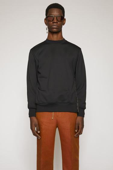 Acne Studios black sweatshirt is made from technical loopback jersey that has a subtle lustre finish and it features a branded zip placket that runs down the side seam.