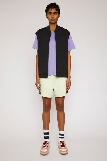 Acne Studios black zipped vest is made from bi-colour bonded fleece and finished with a tonal face-embroidered patch on the chest.