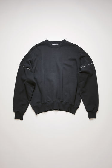 Acne Studios black sweatshirt is made from organically grown cotton and features the tonal logo along the sleeves. It's designed to fall loose over the frame with dropped shoulders.