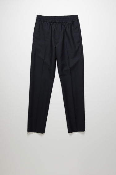 Acne Studios Ryder L Wo Mh navy trousers are crafted from a lightweight wool and mohair blend and shaped with slim legs with a mid-rise elasticated waistband.