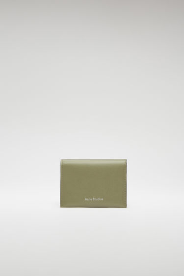 Acne Studios dark green/black cardholder is crafted from grained leather to a folded construction and features four card slots and a silver stamped logo on front.