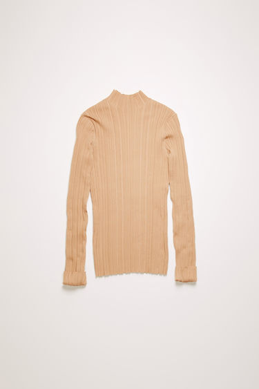Acne Studios cream beige mock neck sweater is knitted from mercerized cotton with an irregular ribbed pattern and has a slim-fitting profile.