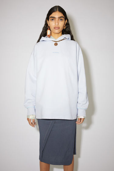 Acne Studios pale blue hooded sweatshirt is made of cotton with an Acne Studios logo at the centre chest