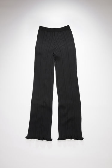 Acne Studios black irregular rib casual trousers have an elastic waistband and a classic fit.