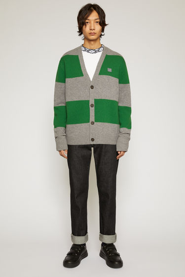 Acne Studios grey melange/deep green block-stripe cardigan is knitted from wool to a relaxed silhouette and accented with a face-embroidered patch on the chest.