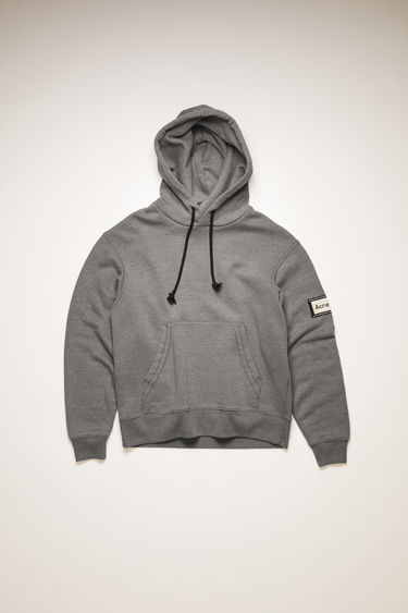 Acne Studios graphite grey hooded sweatshirt is crafted from midweight loopback jersey with a kangaroo pocket and features a reversed label patch on left sleeve.