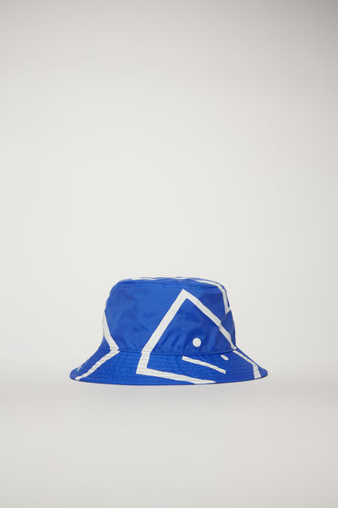 Acne Studios electric blue bucket hat is patterned with a face-motif print and features a flat-topped crown and a quilted brim.