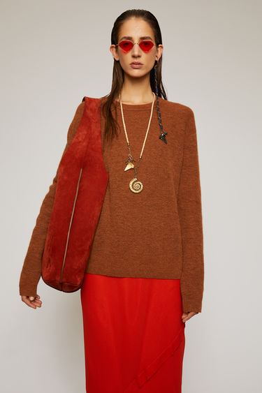 Acne Studios cognac brown sweater is crafted in a full cardigan stitch from an alpaca and wool blend and shaped to a relaxed fit with exposed seams running along the shoulders.