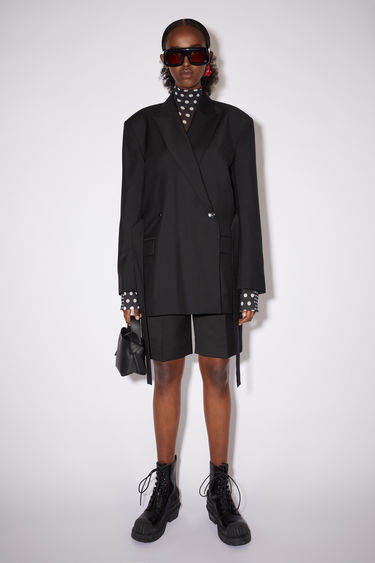 Acne Studios black suit jacket is cut from lightweight wool and mohair-blend to a double-breasted silhouette and features peak lapels, dropped shoulders and a waist belt.