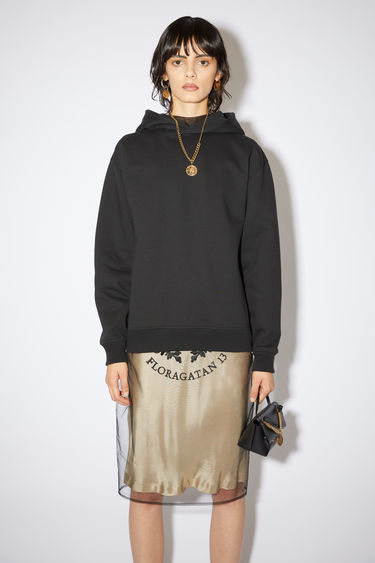 Acne Studios black hooded sweatshirt features ribbed details and an Acne Studios logo tab.