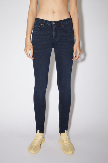 Acne Studios Climb Blue Black jeans are crafted from super stretch denim that's washed for a soft, faded finish. They're sit at a mid rise with skinny legs that taper and crop at the ankles.