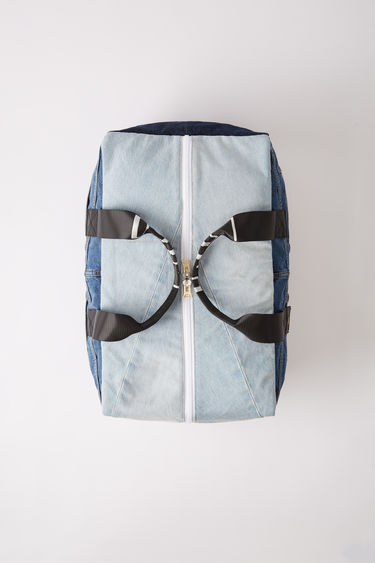 Acne Studios Blå Konst recrafted denim patchwork kit bag with duel shoulder straps.