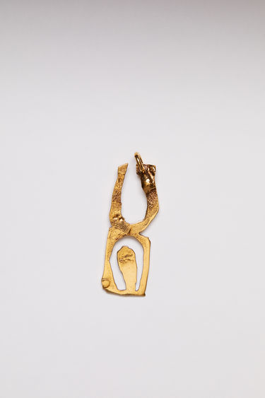 Acne Studios pendant is crafted from a hammered gold-tone brass and features a stencil of the letter 'U'  The pendant can be personalised with a chain necklace.