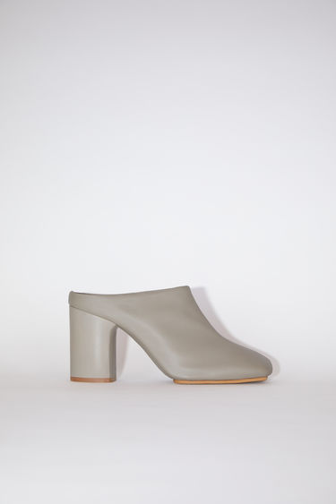 Acne Studios beige soft leather mules have square toes and chunky heels.