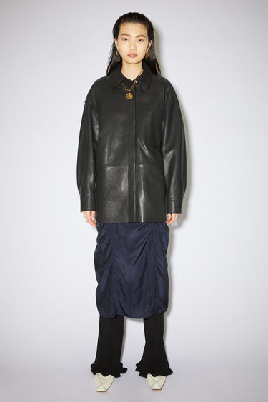 Acne Studios black leather overshirt is fully lined with a relaxed fit.