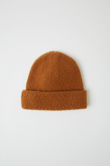 Acne Studios almond brown wool-blend beanie is brushed to create a pilled effect and finished with a classic turn up brim.