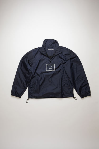 Acne Studios navy jacket is crafted from technical shell lined with mesh and features two slip pockets, a half-zip closure and a face-motif print on front.