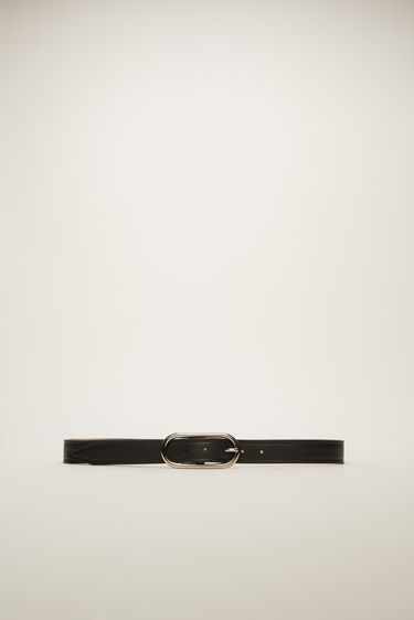 Acne Studios black leather belt is crafted to a slender shape with an oval metal buckle and then delicately punctured with several holes.