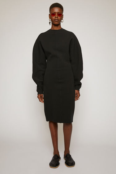 Acne Studios black dress is crafted from a double faced wool blend knit. It's shaped to a form-skimming fit with a round neckline, and is offset with blouson sleeves.