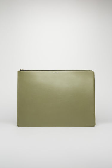 Acne Studios dark green/black document holder is crafted from soft cow leather and accented with a silver-tone zip closure and foil branding on the front.