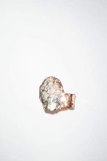 Acne Studios rose copper/blue ring is made of brass, featuring a broken shell.