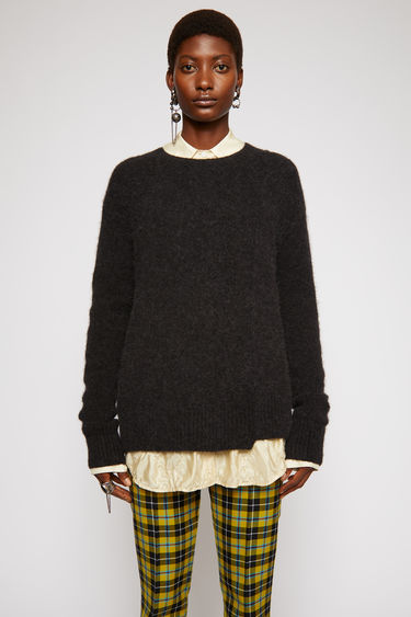 Acne Studios black sweater is crafted from an alpaca blend with hints of wool for a soft hand feel. It's shaped with a crew neck and finished with a stepped hemline.