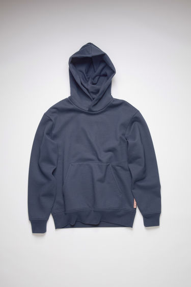 Acne Studios blackbird blue hooded sweatshirt is made of a cotton blend, featuring an Acne Studios logo tab on the lower side.