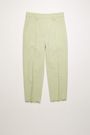 Acne Studios pastel green wool-blend trousers are cut to a tapered-leg fit with a mid-rise waist and neatly finished with two front slip pockets and one jetted pocket at the back.