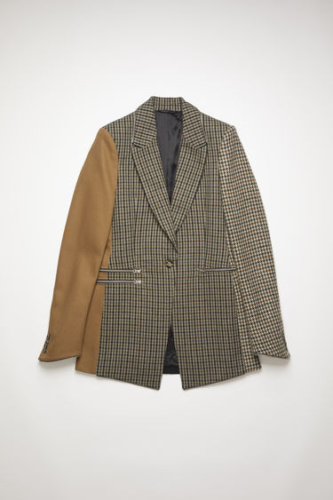 Acne Studios brown/black panel suit jacket is crafted from repurposed wool and cotton fabrics, featuring zip details on side pockets and hem. Shaped to a fitted waist and one button closure.