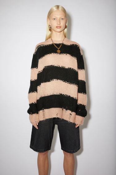 Acne Studios black/warm beige sweater is designed in an oversized shape with extended sleeves and patterned with jagged block stripes. It's shaped with a thick ribbed collar and features distressing around the hem and cuffs.