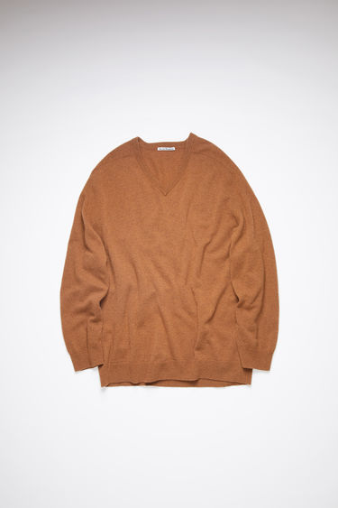 Acne Studios dark camel long sleeve polo sweater is made of lambswool with rib knit details at the cuffs and hem.