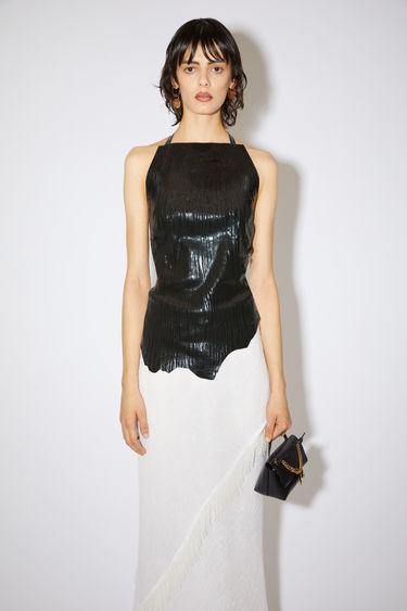 Acne Studios black metallic top is made of leather with tie closures.
