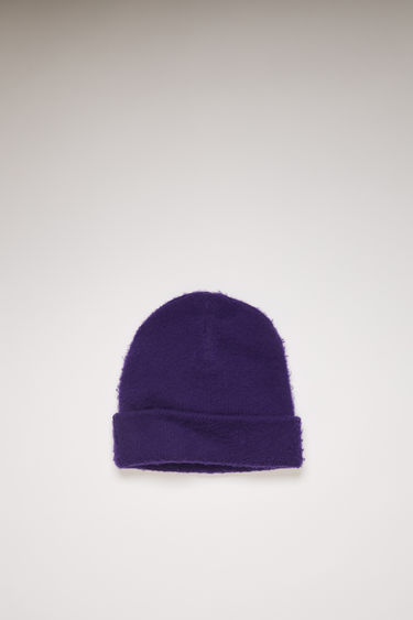 Acne Studios deep purple beanie is knitted from soft wool and cashmere-blend yarn that's brushed to create a fuzzy pilled effect then neatly finished with a turn-up brim.