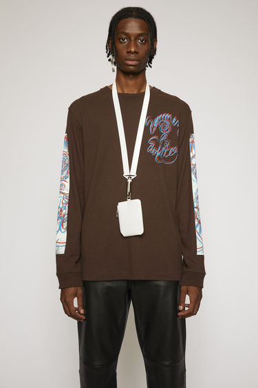 Acne Studios coffee brown t-shirt is cut to a relaxed silhouette from lightweight jersey and printed 'Summer Solstice' in a handwritten-style on the chest and down the sleeves.