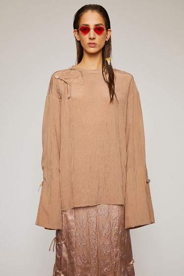 Acne Studios old pink blouse is crafted from a crinkled, fluid viscose and features bell sleeves, loop knot closures and an exaggerated back vent.