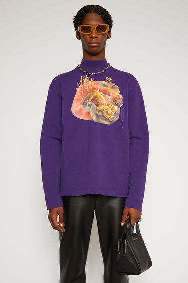 Acne Studios deep purple roll-neck top features a dinosaur print and a patch on front. It's crafted from organically grown cotton that's garment dyed for a soft handle and shaped to a relaxed silhouette with long sleeves.