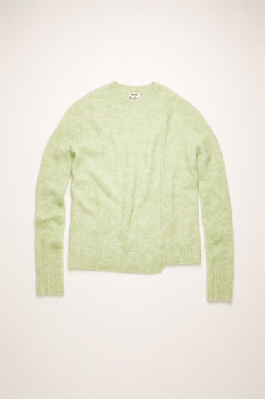 Acne Studios pistachio green sweater is crafted from an alpaca blend with hints of wool for a soft hand feel. It's shaped with a crew neck and finished with a stepped hemline.