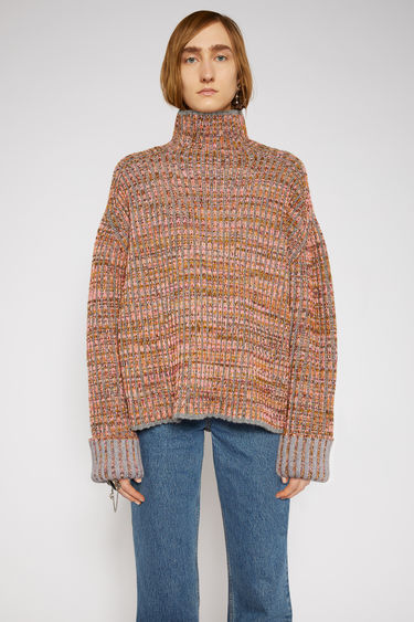 Acne Studios fluo pink/multi sweater is spun with a traditional ribbed texture and that's dotted with multicoloured flecks. It's shaped with a mock neck and dropped sleeves to accentuate the relaxed, boxy silhouette.